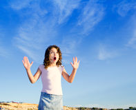 Girl open arms outdoor under blue sky Stock Photo