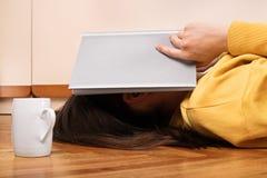 Girl with an open book over her head Stock Photos