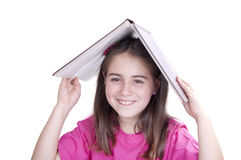 Girl with an open book over her head Stock Image