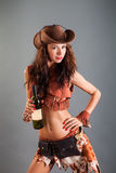 Girl in Open Cowboy Dance Costume Hat Poses with Bottle Royalty Free Stock Images