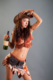 Girl in Open Cowboy Dance Costume Hat Poses with Bottle Stock Photos