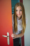 Girl and open door Stock Image