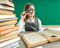 Girl open-eyed with magnifier Royalty Free Stock Images