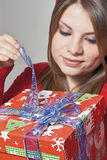 Girl open the gift Stock Images