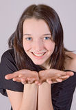 Girl with open hand Stock Image