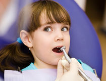 Girl  with open mouth during drilling treatment at the de Royalty Free Stock Photos