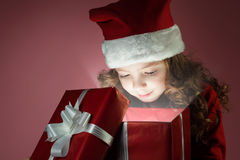 Girl open open gift box Royalty Free Stock Image