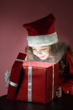 Girl open red gift box Stock Images