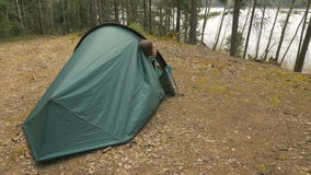 Girl open the tent in the forest stock video footage