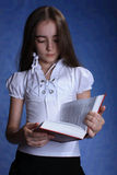 Girl with opened red book. Isolated Royalty Free Stock Photo