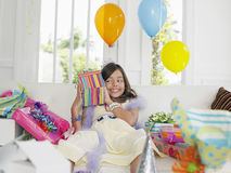 Girl Opening Birthday Presents Stock Photography