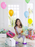 Girl Opening Birthday Presents Royalty Free Stock Photos