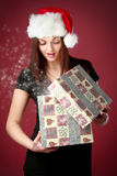 Girl opening christmas gift Royalty Free Stock Photos