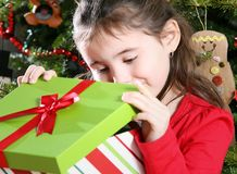 Girl opening Christmas present Stock Photos