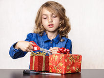 Girl opening Christmas present Stock Photography