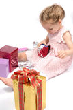 Girl opening Christmas presents Stock Photography