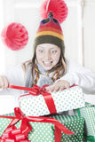 Girl opening Christmas presents Royalty Free Stock Photo