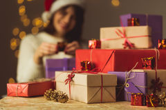 Girl opening Christmas presents Stock Image