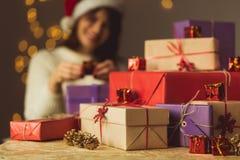 Girl opening Christmas presents Stock Image