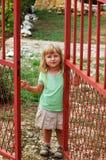 Girl opening door stock photo