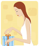 Girl opening gift Stock Photo