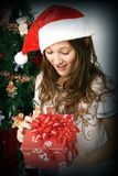 Girl opening a gift Royalty Free Stock Photo