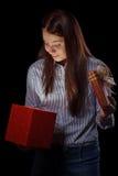 Girl opening gift box Stock Photos
