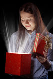Girl opening gift box Royalty Free Stock Photos