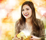 Girl Opening a Gift Box Stock Image