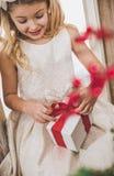 Girl opening gift box Royalty Free Stock Photos