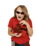 Girl opening gift on white Stock Images