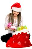 Girl opening gifts Stock Photos