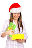 Girl opening gifts Royalty Free Stock Images