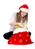 Girl opening gifts Stock Image