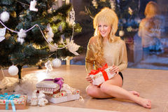 The girl opening the gifts Stock Image