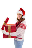 Girl opening a magical christmas gift Royalty Free Stock Photos