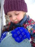 Girl opening mailbox in Winter. Closeup of young girl in Winter hat and gloves opening outdoor mailbox Stock Photos