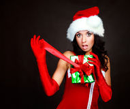 Girl opening a present royalty free stock photos