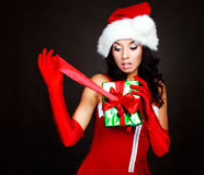 Girl opening a present Royalty Free Stock Photo