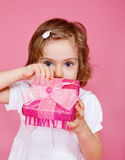 Girl opening present Royalty Free Stock Photo