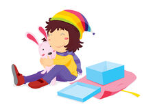 Girl opening present Royalty Free Stock Images