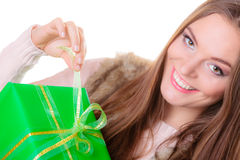 Girl opening present big green gift box isolated Stock Images
