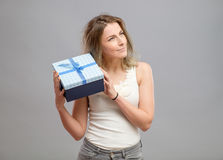 Girl opening a present isolated. Girl opening present isolated on grey background Royalty Free Stock Image