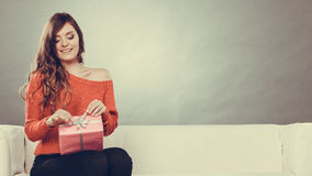 Girl opening present pink gift box Royalty Free Stock Images
