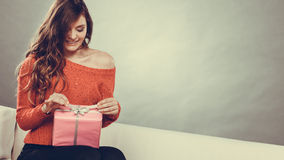 Girl opening present pink gift box Stock Photo