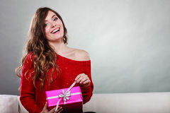 Girl opening present pink gift box Royalty Free Stock Photo