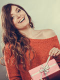 Girl opening present pink gift box Stock Image