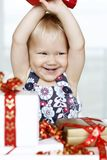 Girl opening presents Stock Image