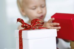 Girl opening presents Royalty Free Stock Photography