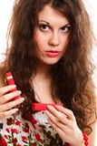 Girl opening small red gift box isolated Stock Photos